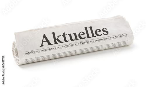 Leinwanddruck Bild Zeitungsrolle mit der Überschrift Aktuelles