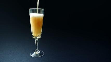 Champagne Poured Into Elegant Glass