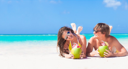 close up of young couple lying on a tropical beach in Barbados