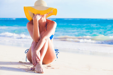 portrit of young woman in sun hat at beach