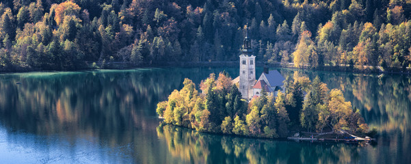 church in autumn on the lake in Slovenia