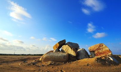Big boulder stone with sky blue background