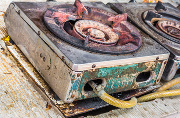 Old gas burner and stove close up