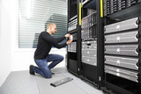 It consultant replace harddrive in datacenter poster