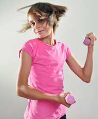 child exercising with dumbbells