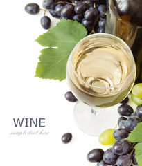 white wine and grapes with fresh leaves