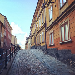 Cobblestone street with old buildings in Stockholm