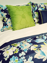 Blue and green bed linen with floral design