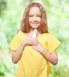 Girl holding an energy saving lamp