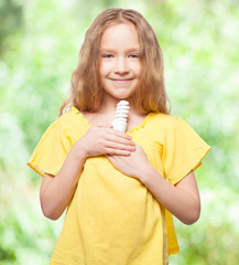 Girl holding an energy saving lamp