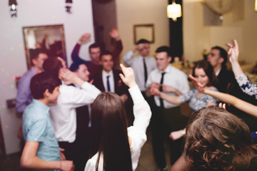 Young people having fun dancing at party
