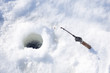 hole in  ice and fishing tackle