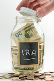 Hand opening glass Jar used for IRA fund poster
