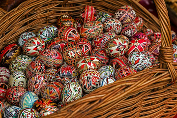 Wicker basket with Easter painted eggs