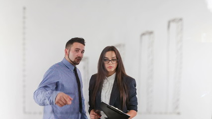 Young woman shows a businessman schedule growth
