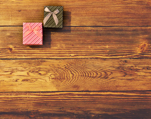 Two Gift Boxes on Wooden Background