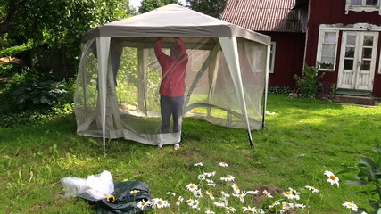 People attach protective tent bower net in garden house yard