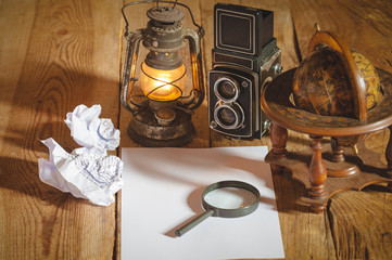 Vintage still life stuff on a rustic wooden table,retro camera,