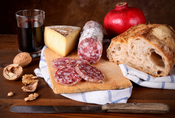 Bread, red wine, cheese and salami