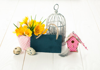 easter decoration with quail eggs, birdcage, yellow Spring Crocu