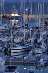 Italy; 29 march 2015, yachts in the marina at sunset - EDITORIAL