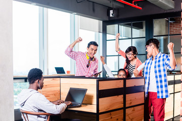 Start-up business people in cubicles