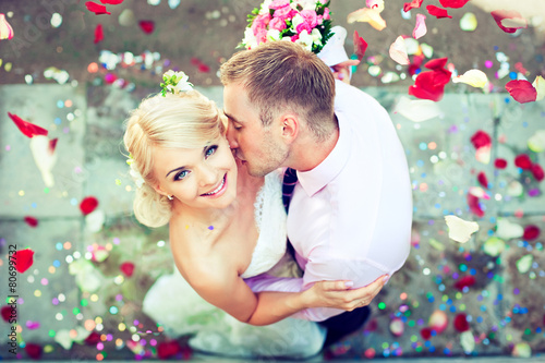 Beautiful wedding couple , groom kisses the bride poster