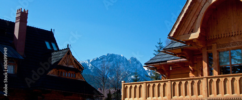 Guesthouse and mountain snowy landscape horizon - 80699949