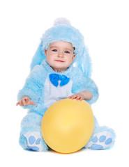 baby girl wearing rabbit fancy dress sitting on the floor