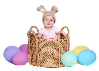 baby wearing  rabbit hat sitting in a basket