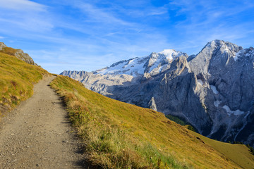 Hiking path and view of Marmolada in Dolomites Mountains, Italy