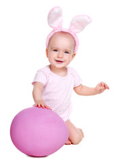 front view of a baby girl holding giant pink easter egg