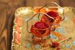 saffron spice in antique vintage glass bowl, closeup - 80700941