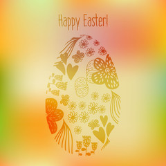 Easter greeting card with egg on a blurred background