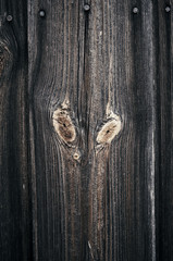 Vertical detail background of old wooden decorative wall surface