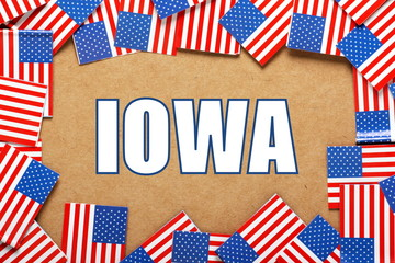 The title IOWA with a border of USA flags
