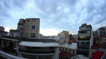 overview of Athens roofs at dusk