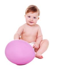 baby girl holding giant pink easter egg