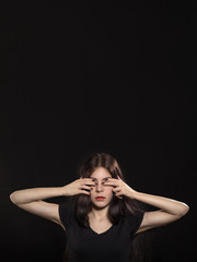 woman covers her eyes