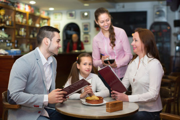 Waitress and family at cafe