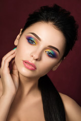 Beauty portrait of woman with colourful eye makeup