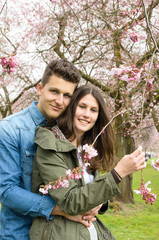 young couple in love and cherry blossoms :)