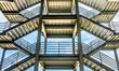 Leinwanddruck Bild - The silhouette of structure of iron stairway