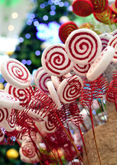 Lollipop Christmas decoration on a Christmas trees background