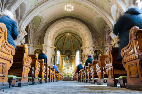 Fotobehang Bedehuis Sunday mass in catholic church wide angle