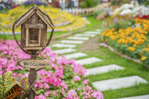Ornate Mailbox in colorful garden - 80708917