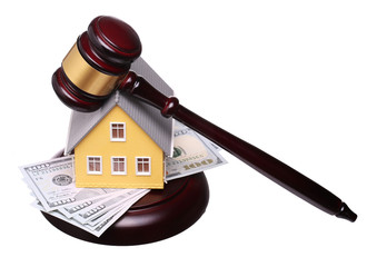 Concept of house sale with gavel and money isolated
