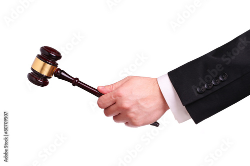 Gavel in hand isolated - 80709507