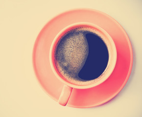 Coffee in an orange cup