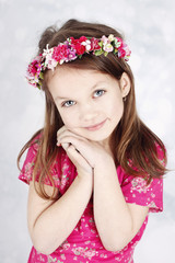 Beautiful girl with floral wreath